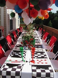 Black and white checked table runners for an Alice in Wonderland party