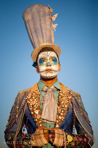 buttons, Mardi Gras beads, cuffs from gloves with mirrors and buttons...nice painted face too