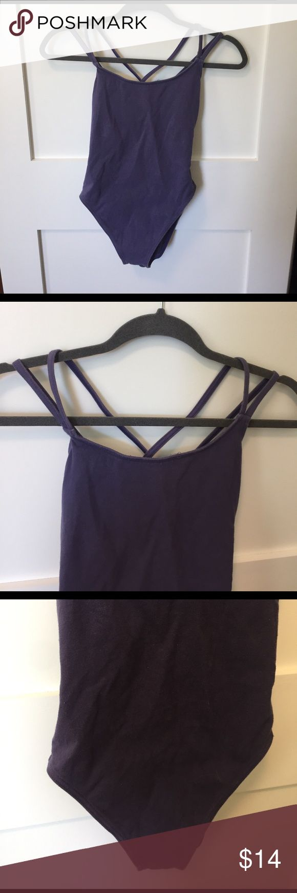 Capezio - Double Cross Back Leotard Purple leotard with yellow cross back. Slight discoloration on one strap and two spots on interior, but not visible on exterior. Capezio Swim One Pieces