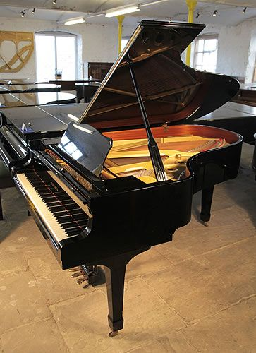 A 1986, Yamaha C5 grand piano for sale with a black case and spade legs at Besbrode Pianos