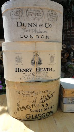Display of vintage creamy colored English hat boxes #packaging #design
