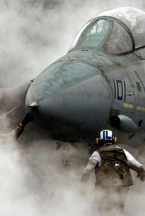 F-14 Tomcat going to work, wow!!! Great picture!! Looks like the dessert to me. DUST???