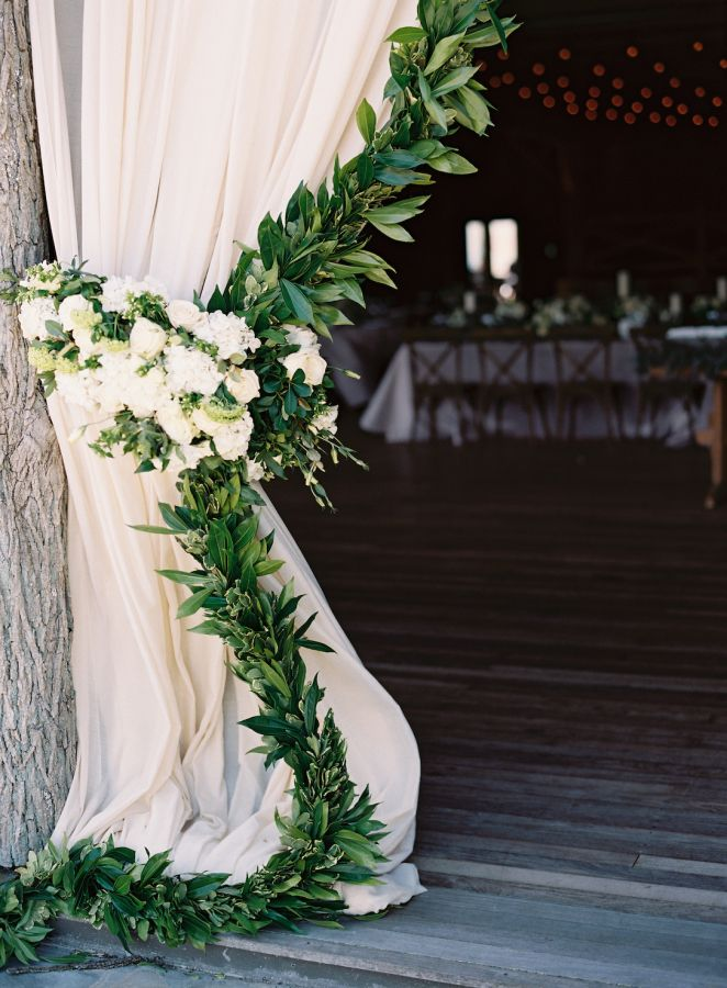 Elegant garland adorned curtains: http://www.stylemepretty.com/2015/11/06/rustic-elegance-at-camp-yonahnoka/ | Photography: Clark Brewer - http://www.clarkbrewerphotography.com/