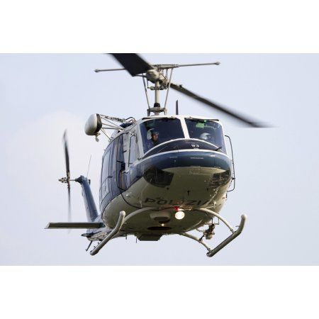 An Agusta Bell 212 of Italys State Police in flight over Italy Canvas Art - Luca NicolottiStocktrek Images (34 x 23)