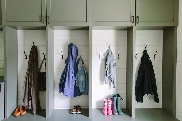 Family friendly mudroom features gray mudroom cabinets adorned with oil rubbed bronze pulls stacked over open mudroom lockers lined with shiplap.