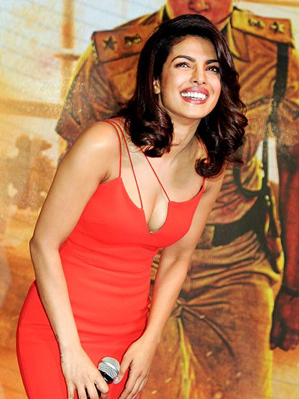 Star Tracks: Thursday, December 24, 2015 | TALKING POINTS | Quantico actress Priyanka Chopra stuns in red as she takes the stage at a media event in Mumbai, India, on Tuesday.