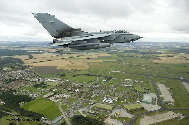 A Tornado GR4 aircraft of 617 Squadron, Royal Air Force made famous by the Dambusters, flies high over it's parent station of RAF Lossiemouth in Scotland.