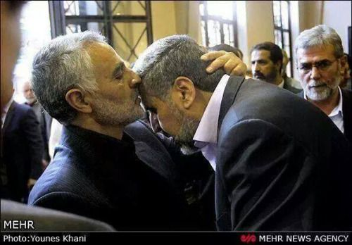 Brigadier General Qasem Suleimani, Commander of Iran's IRGC Quds Forces, greets and kisses the forehead of Ramezan Abdullah, Commander of Palestinian Islamic Jihad Forces