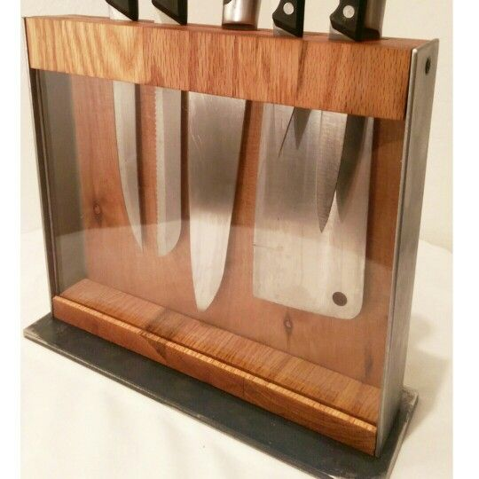 "Industrial knife block. Wood and steel with glass front.  Universal knife block design allows any combination of knives to be stored and displayed.  Hidden Magnets keep knives neat and upright.  Two 10"" slots provide 20"" of knife storage possibility"