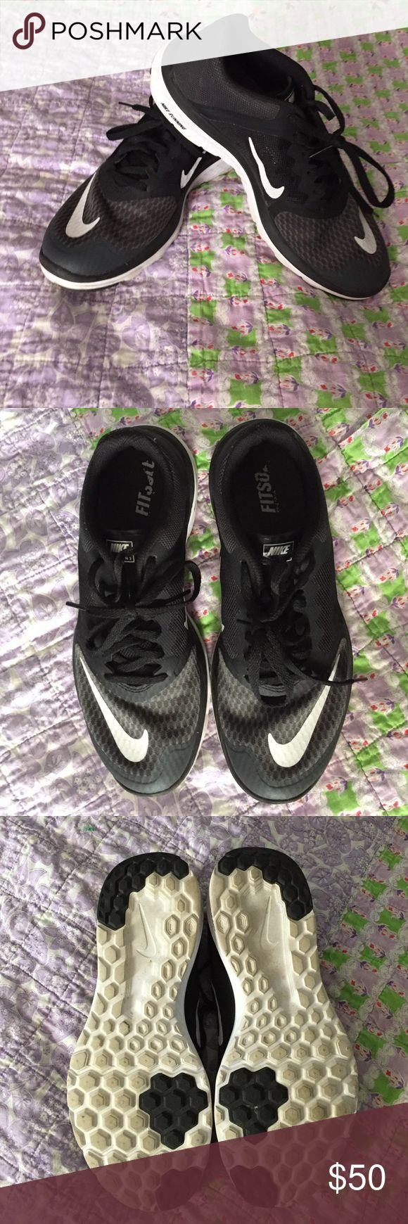 Nike Tennis shoes Black and white Nike lite runs. Worn once. Perfect condition. Comes with a Nike box. Nike Shoes Sneakers