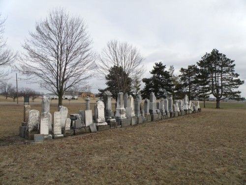 The cemetery was hit by an F4 tornado during the Palm Sunday outbreak of 1965.  The stones were scattered everywhere, and then lined up on concrete slabs because no one knew where each stone went.  Saint Jacobs Lutheran Cemetery, Anna, Ohio