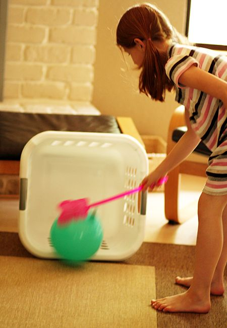 Easy game idea with stuff you find in any house: flyswatter, laundry basket and balloon