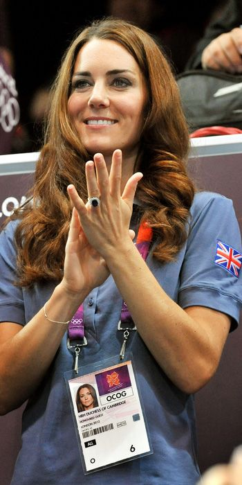 AUGUST 5, 2012 Catherine cheered on Team Great Britain's handball players in a polo shirt, and had an official lanyard on that read HRH Duchess of Cambridge, Honored Guest. Like anyone needed reminding!