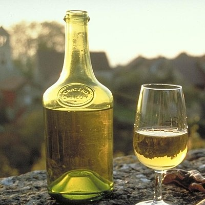 A glass of Vin Jaune and the traditional bottle used in the region of Jura called Clavelin