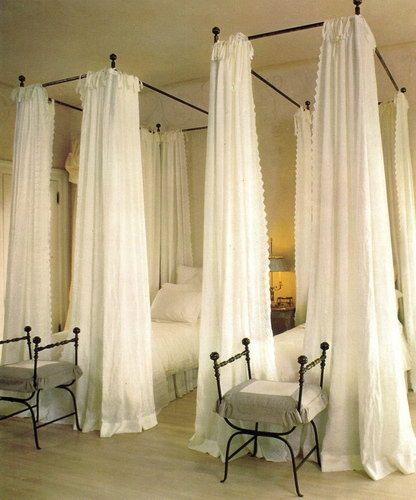 long curtains create mini rooms for privacy in a shared room