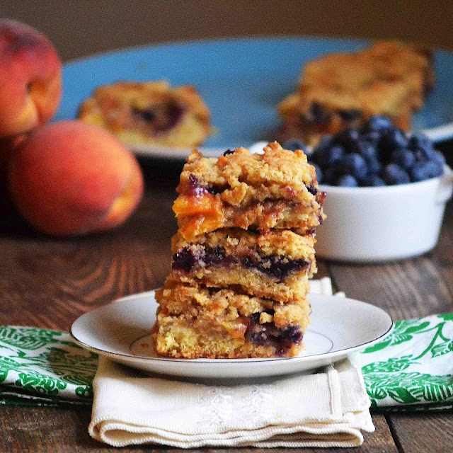 Blueberry Peach Cobbler Bars. The perfect hand held fruit cobbler. @bakeaholicmama