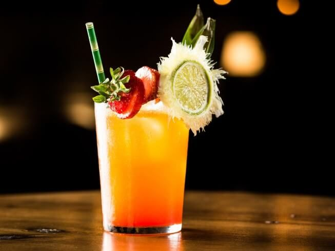 A recipe for Fuzzy Navel made with peach schnapps, orange juice, vodka, cranberry or raspberry juice, lime