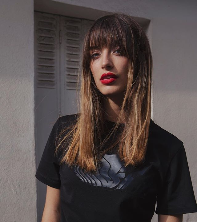 French model Louise Follain will make you want bangs and a red lip immediately