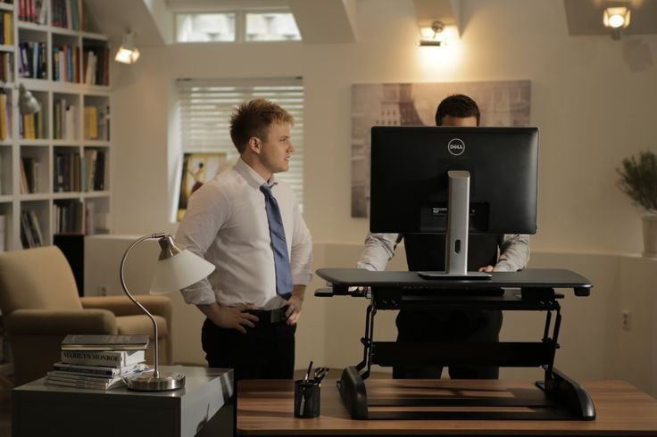 A VARIDESK standing up desk as a perfect environment for sharing what's on your computer with others -