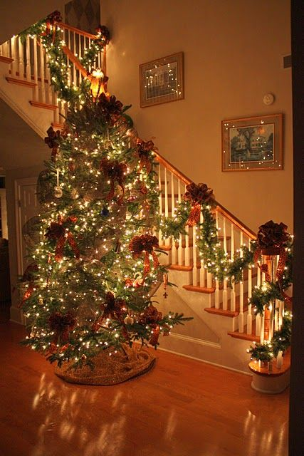 Looks just like my stairs!  I like the draped garland so I think I'll try that this year instead of wrapping it.  Maybe try the tree here as well???