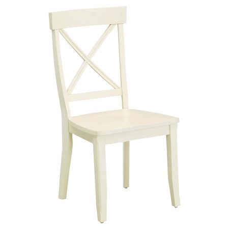 Creamy white side chair with an x-shaped back.  Product: Set of 2 chairsConstruction Material: WoodColor:...