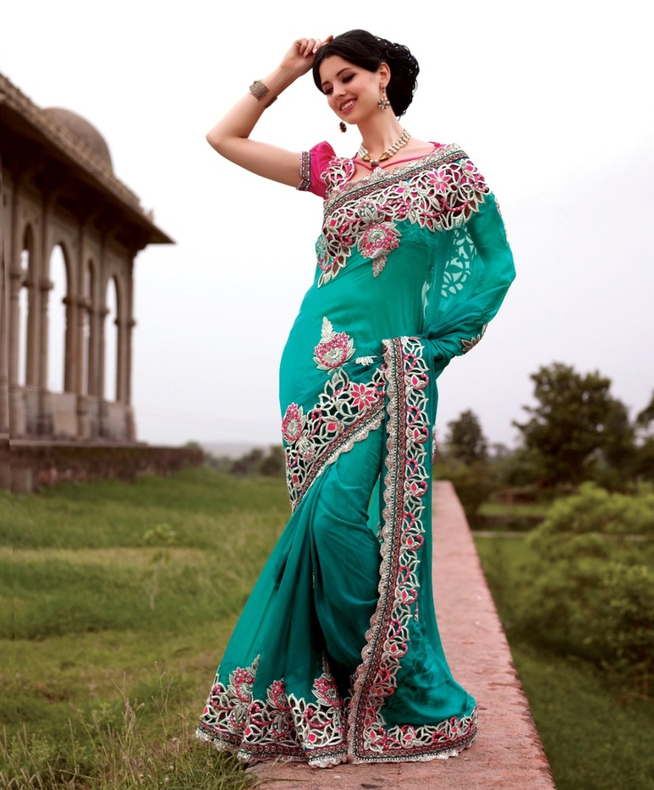 Refreshing sea blue saree engraved on bember and dupian material.    For more details visit www.ashika.com