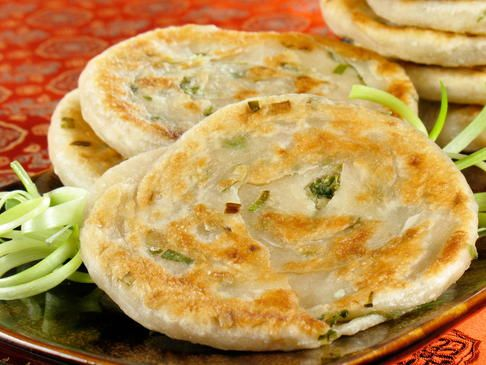 Eaten as a snack, appetizer or meal, the secret to making any jun crispy is to use very cold water in the batter. Rice flour gives it a slightly chewier, stickier texture. If you can't find rice flour, you can use all-purpose flour instead. This is the recipe for basic green onion pancakes, but you can add sliced mushrooms (oyster or shiitake), carrots, mung bean sprouts, or red peppers.