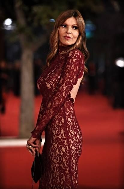 Italian red carpet.... Rita Rusic, the stunning Italian actress / movie producer, is wearing a gorgeous handmade gown, totally in hand embroidered lace #fabic by #pierlorenzobassettitessuti via del Gesu' 60 #roma labelled La Piazzetta di Capri A wonderful nude look, in the night of Rome....