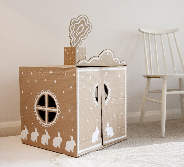 UKKONOOA // Cardboard house with white painted accents