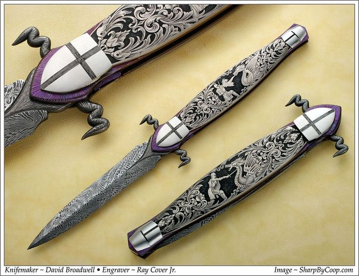 "This is another collaborations between Broadwell and Ray Cover. The knife was commissioned at a show that both men were attending, and they brainstormed the details while driving for 6 hours. The knife features Tom Ferry's mosaic damascus, and the ""guard"" of this dagger was carved into dragon's tails as an integral part of the blade. The front pieces are actually the pivot carved into the shape of the knight's shield, while the rear pieces his helmet. These overlap the ends of the titanium…"