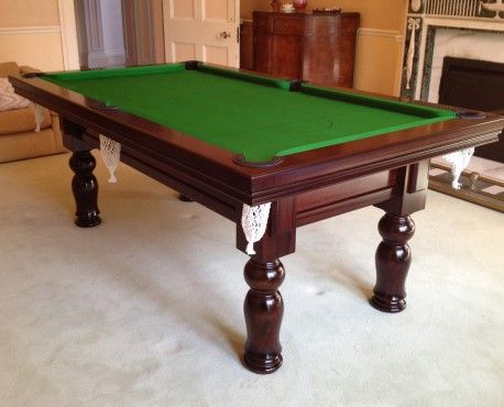 Royal Executive 7ft UK Pool Table manufactured in oak with a dark oak satin finish and tulip leg. Shop here: http://www.snookerandpooltablecompany.com/pool-tables/uk-pool-tables/traditional-bespoke-uk-pool/royal-executive-7ft-uk-pool-table.html