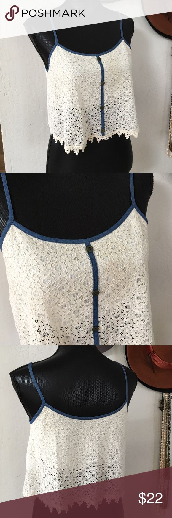 """Cute crop top Cream crop top by Paper Crane with blue denim trim and brass buttons. . Thick cotton lace with built in bra. 17"""" across underarms. 17"""" from shoulder to hem. Like new condition.  Never worn nor washed. Paper Crane Tops Crop Tops"""