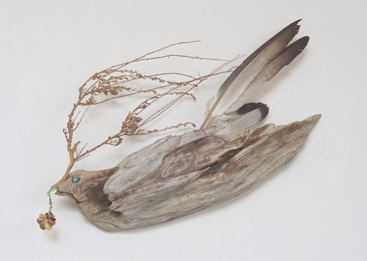 Dove of Peace  by  Masahide Kobayashi  1999  24 (h) x 31 (w) x 7 (d) cm  Mixed Media:  Driftwood,  Sage Branch,  Dove Feather,   Abalone Shell Chip,  Turquoise Bead,  Rainbow-colored Corn Grains