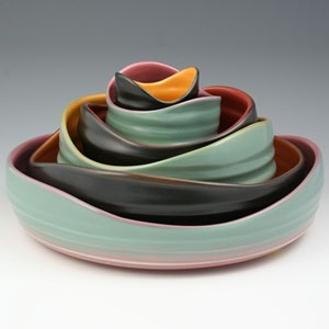 Her pottery is just beautiful! Her glazes are spectacular and the level of skill to create all of her pieces that fit inside one another is quite impressive.
