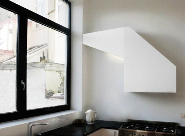 The range hood is one of those bulky things that don't really fit in a sleek and chic modern kitchen but there are ways to make it work. This minimalist design is perfect. It features a sculptural shape and looks more like a decoration that a functional piece. Kitchen Makeover - 28 Kitchen Amenities You'll Wish You Already Had