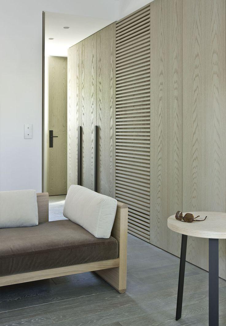 contemporary closet design, white oak closet doors, dark hardware, simplicity of closet design