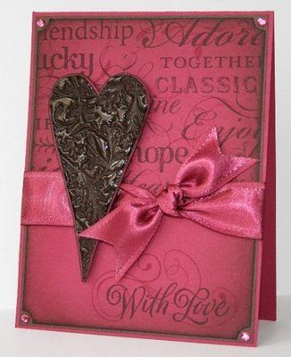 "For the heart, I stamped it with VersaMark onto the chocolate card stock and heat embossed with about 4 layers of UTEE (stamp once...apply UTEE...heat until ""droplets"" of UTEE form...remove heat tool and quickly sprinkle on more UTEE...heat again...this time the UTEE will begin to smooth out to a glass-like finish...sprinkle on more UTEE...heat again...repeat as many time as you wish for depth). While the fourth layer was still molten, I pressed the Filigree stamp into it to give it that…"