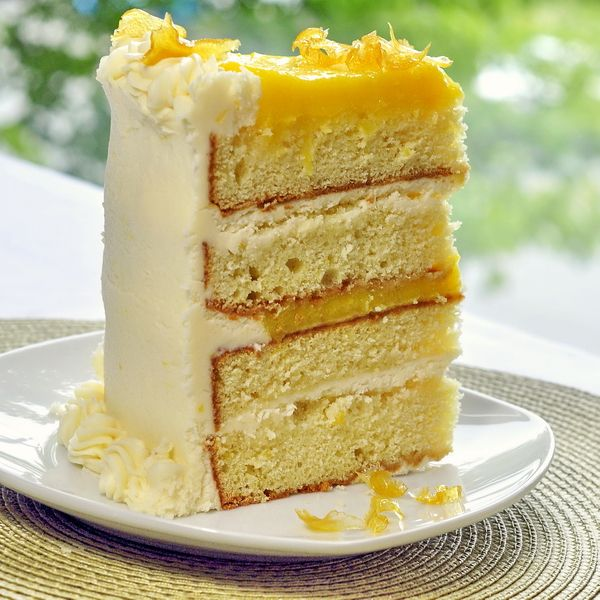 The Ultimate Lemon Cake ~ Says: I start with a homemade lemon scratch cake which gets brushed with some tangy lemon syrup, then filled with alternating layers of rich lemon curd and lemon buttercream frosting before being covered in more of the lemon frosting and finally garnished with homemade candied lemon zest. This is the perfect celebration cake for that lemon lover in your life.