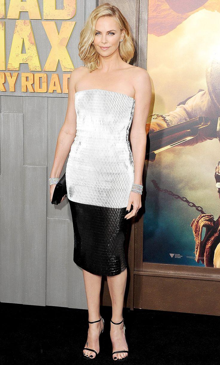 H Charlize Theron στην πρεμιέρα της σκοτεινής περιπέτειας επιβίωσης και φαντασίας 'Mad Max' με στράπλες δημιουργία Dior με δικτυωτό ύφασμα και διαμαντένια βραχιόλια Harry Winston. http://pressmedoll.gr/