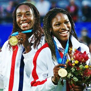Venus and Serena Williams won their first Olympic gold medal in doubles at the 2000 Sydney Olympics. (AP Photo/Amy Sancetta)
