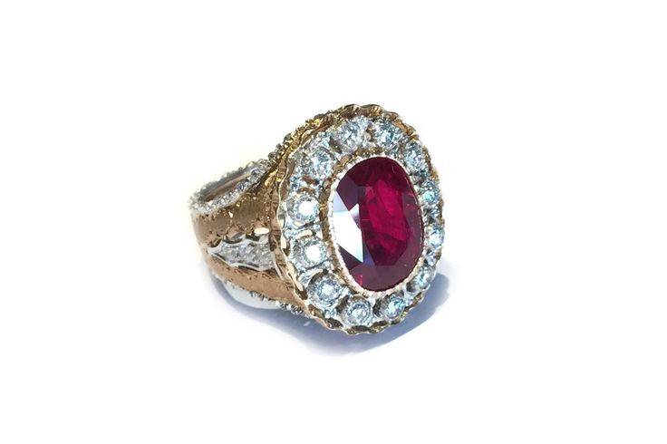 Mario Buccellati Estate Ring with Important Cushion-cut Ruby and Diamonds, 18k Yellowand White Gold.