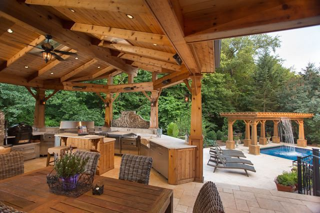 in love with this outdoor kitchen overlooking the pool and waterfall naperville outdoor on outdoor kitchen and living space id=91339