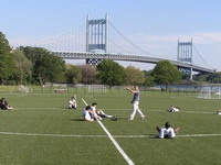 Randall's Island ball field.  I'm not sure how it might have changed - the Upper East Side Bar League once played an entire game with a dead body just past the outfield near that bridge.  Hey - we New Yorkers can take anything!!!
