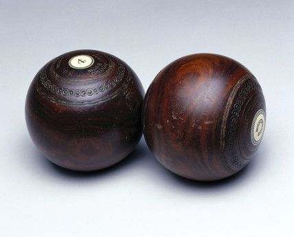 Antique bowling balls - wood with ivory inserts