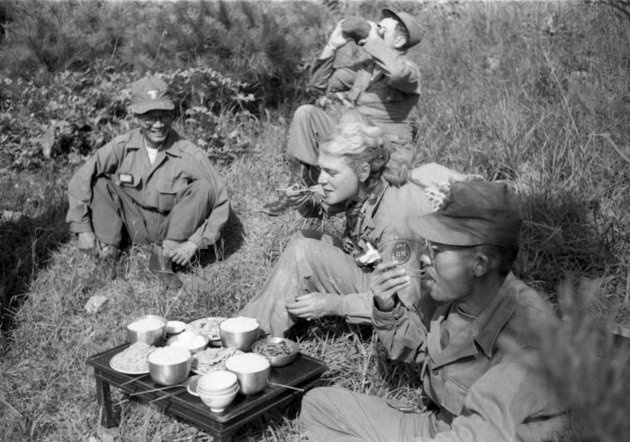 Margaret Bourke-White shares a meal with South Korean troops in the field, 1952.