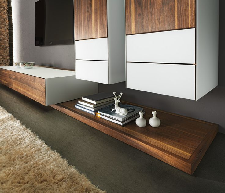 Cubus Pure media cabinets shown in walnut and white glass