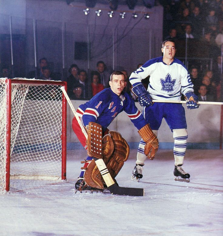 Ed Giacomin minds the Rangers net as Frank Mahovlich looks for the tip-in