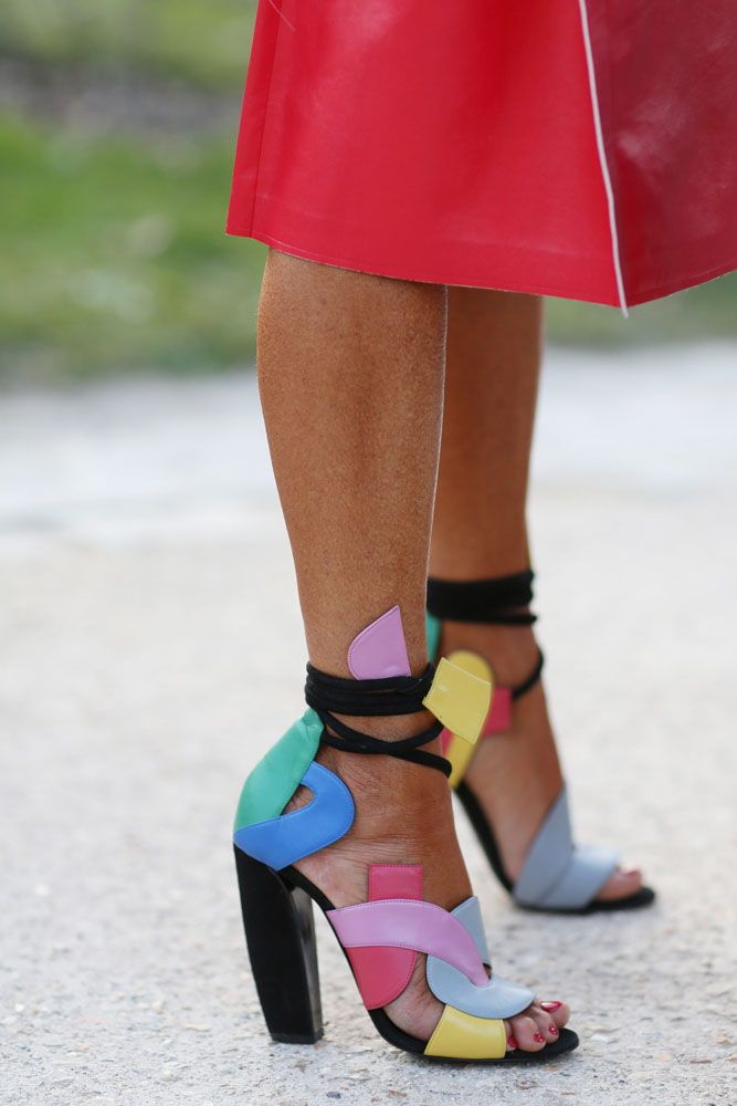 Cut outs in rainbow colours at #PFW #AW15 . WGSN Street Style Shot