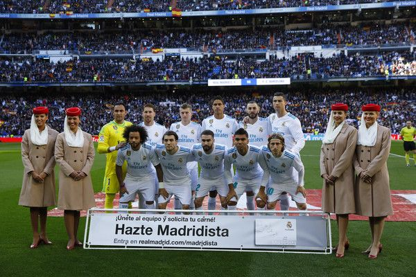 The Real Madrid team line up prior to the La Liga match between Real Madrid and Barcelona at Estadio Santiago Bernabeu on December 23, 2017 in Madrid, Spain.