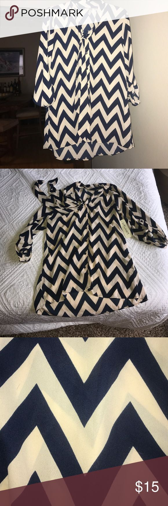NWT Tacera Chevron Top Tan and blue chevron top. Perfect for he office. Super cute & flattering on. Comes with built in tie around the neck fit for the trend this season. Tacera Tops Blouses